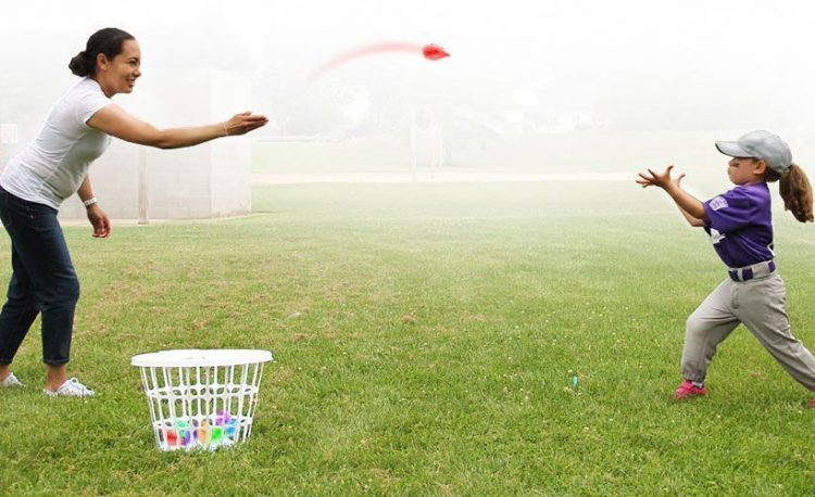 waterballoon toss mother and daughter